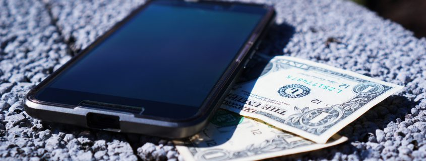 image of cash and mobile phone